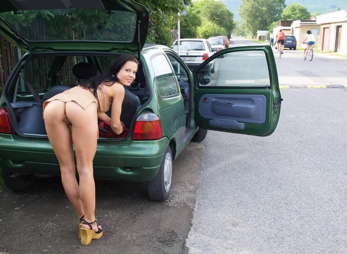 European hotwife bent over the car flashing bare booty