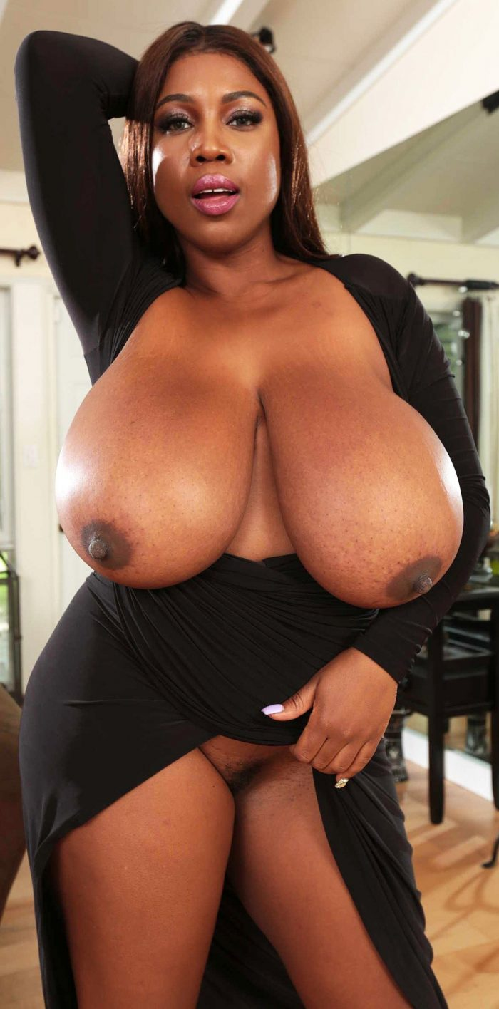 Amazing ebony woman shows massive tits and hairy pussy