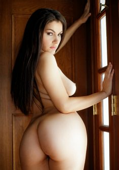 Brunette with long hair shows her sexy ass