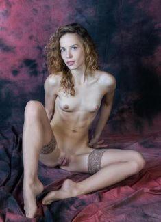 Curly hair blonde posing nude