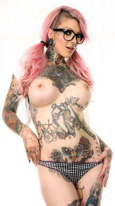 Sydnee Vicious exposes big boobs and fabulous inked curves