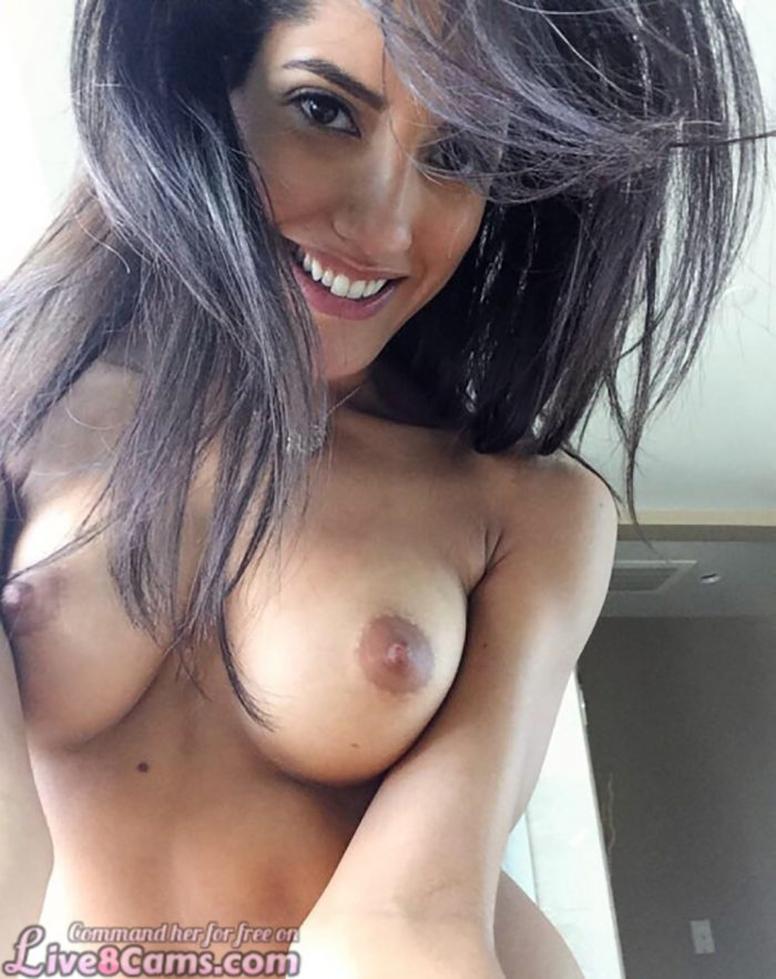 Smiling brunette with big Boobs