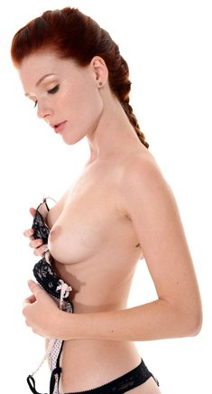 Cute redhead Mia Sollis does a slow striptease and shows her nice pussy