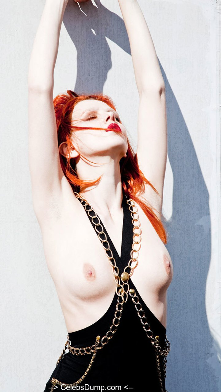 Redhead Tiah Eckhardt topless in nature