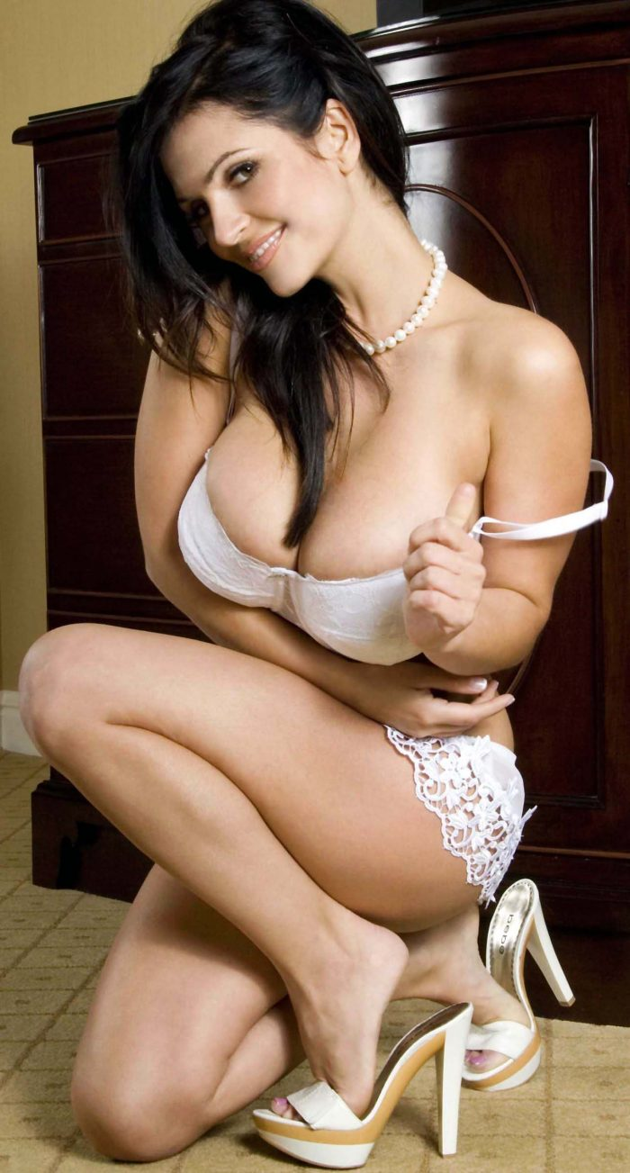 Sexy lady with big tits in white lingerie