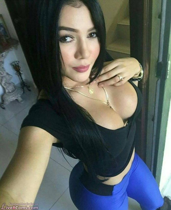 Sexy brunette with big boobs takes a selfie