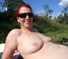 Amateur redhead naked in nature