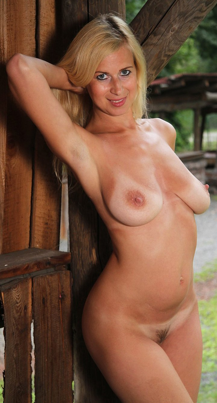 Blonde with big tits Anastasia Devine showing off her gorgeous tanned body