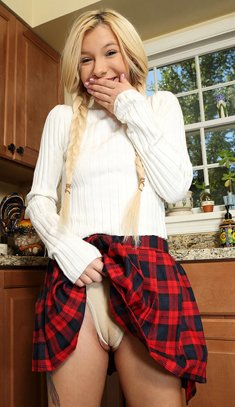 Flexy schoolgirl with pigtails Kenzie Reeves plays with kitchen tools