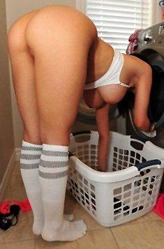 Sexy babe with a fine ass doing laundry
