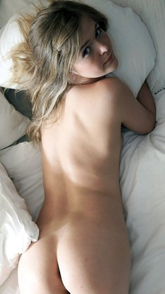 Young cute blonde with shows sexy ass on bed