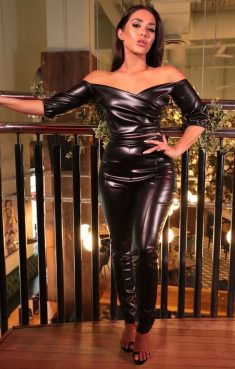 Brunette with sexy body in leather suit