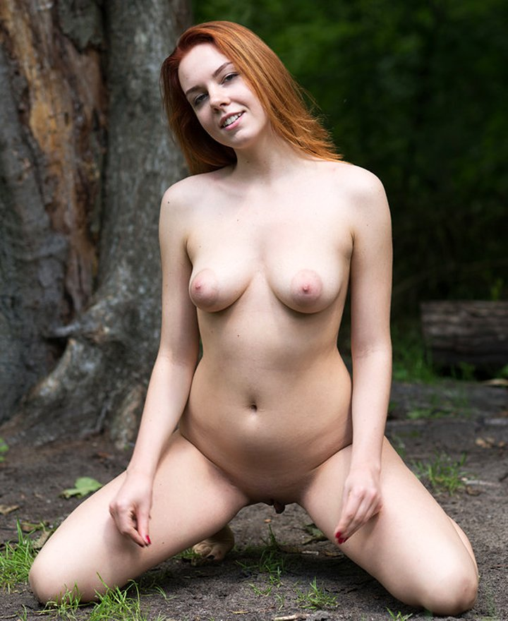 Cute redhead with big tits Candy Red naked in nature