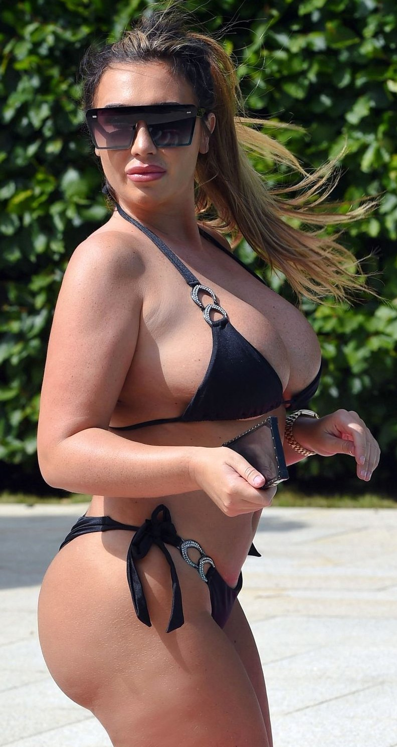Lauren Goodger in black sexy bikini on holiday in Spain