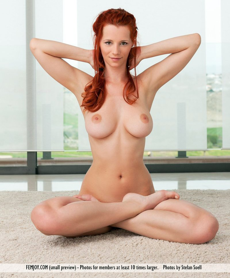 Redhead with big boobs Piper Fawn goes thru her yoga routine in the nude