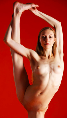 Slim flexible girl Annett A shows tiny tits and shaved pussy
