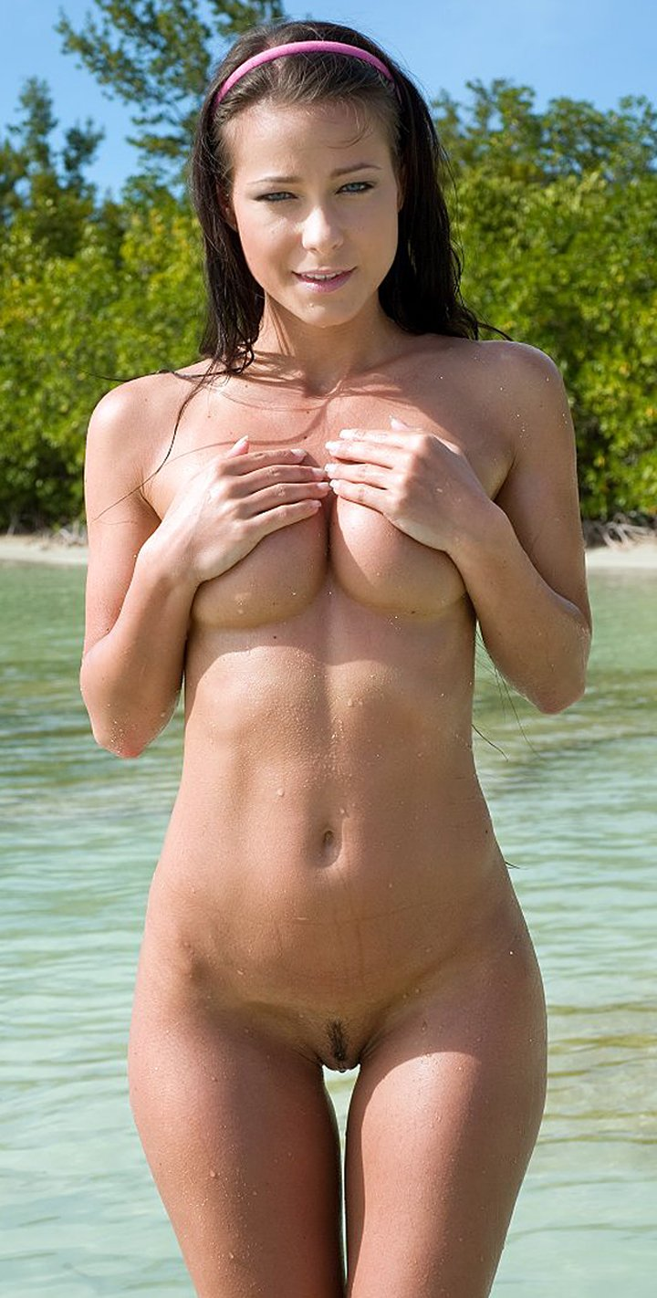 Beautiful brunette Melisa takes off her bikini in shallow water