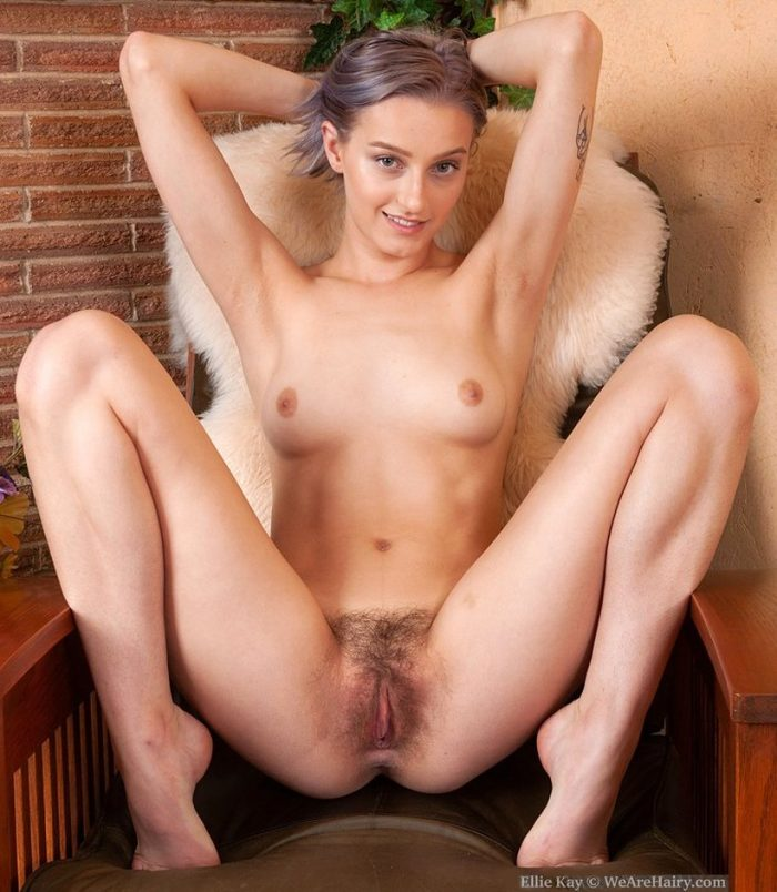 Ellie Kay spreads her legs wide open and shows her hairy pussy