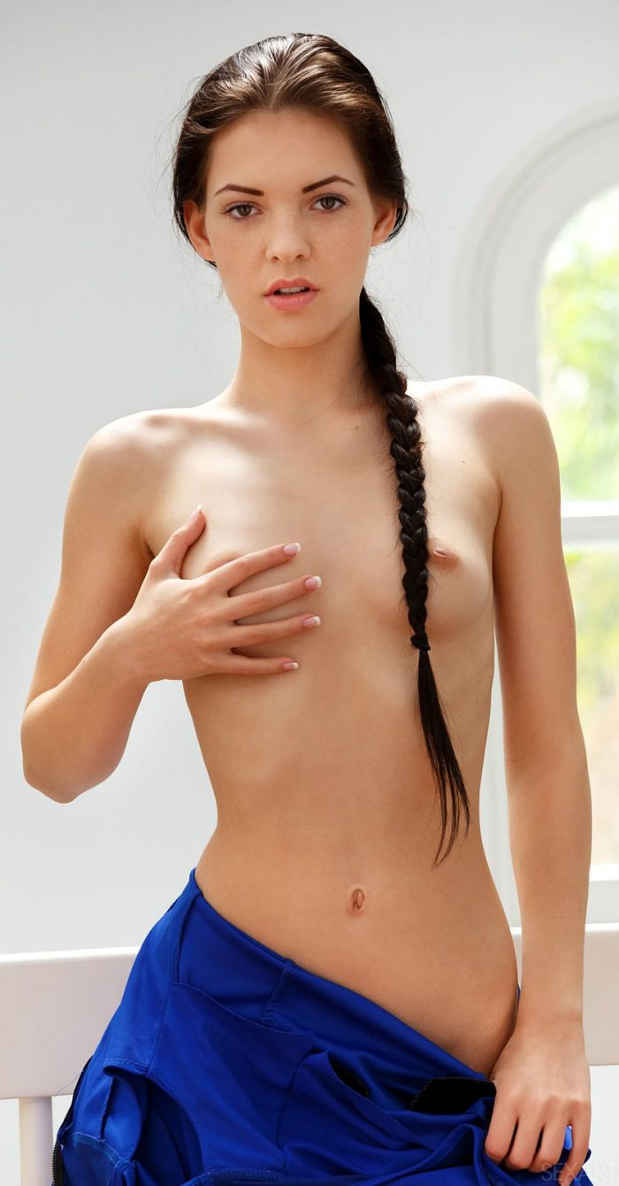Gorgeous brunette Anie Darling strips off dress and touches pussy