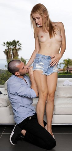 Slim blonde Julia Rain sucks off a big cock after sex on patio furniture