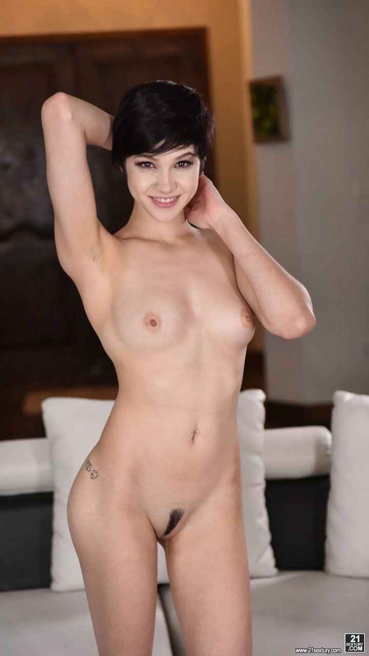 Young schoolgirl Cadey Mercury rocks a striptease to show perky tits