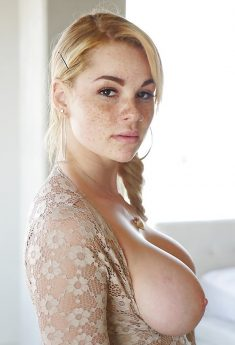 Freckle faced girl Skyla Novea exposing massive natural boobs