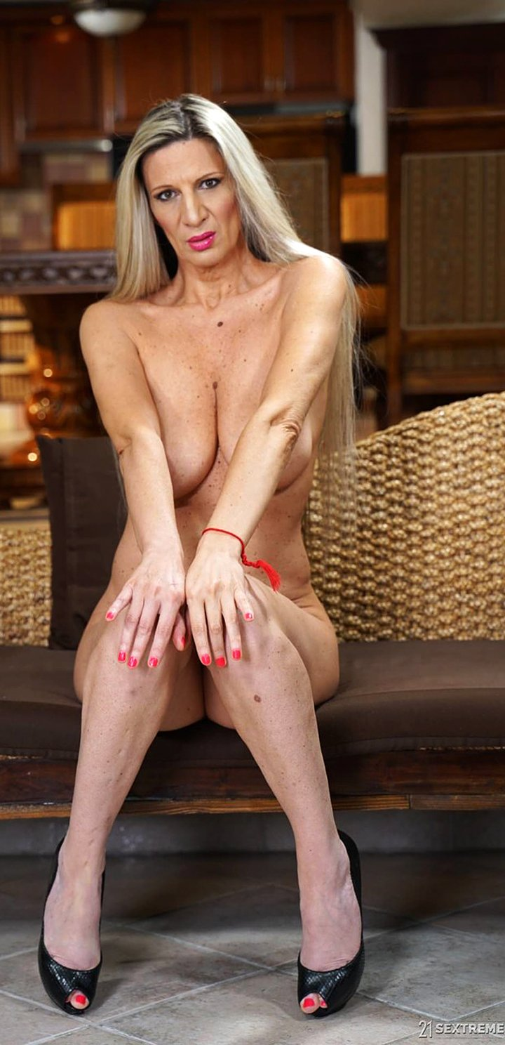 Mature blonde Conchita shows her superb bosom before a hard sex
