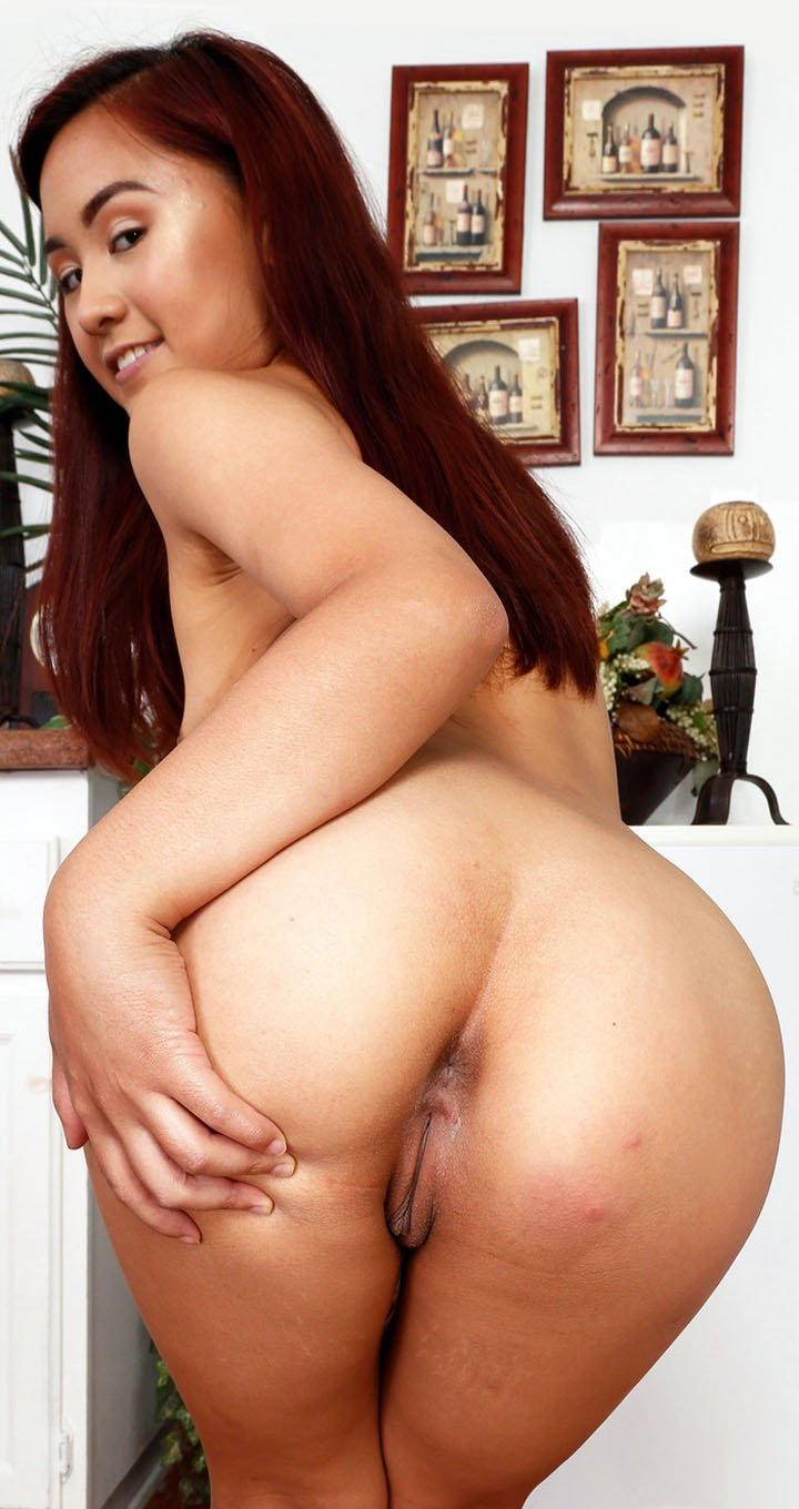 Asian redhead Elle Voneva showcases her yummy feet and nice pussy