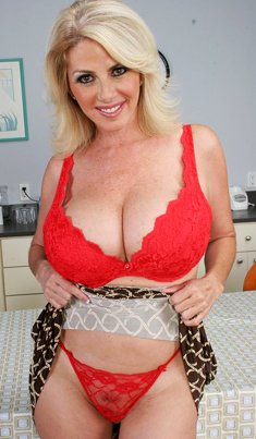 Mature blonde Penny Porsche shows her amazing big breasts and hot butt