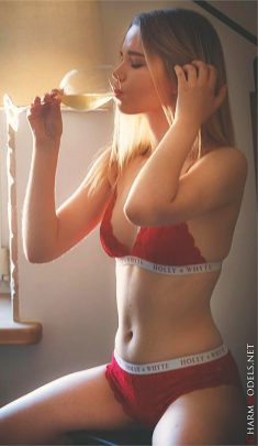 Juna relaxing and drinking wine in red lingerie