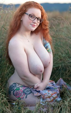 BBW Kaycee Barnes looses her huge tits and gets on her knees in a field