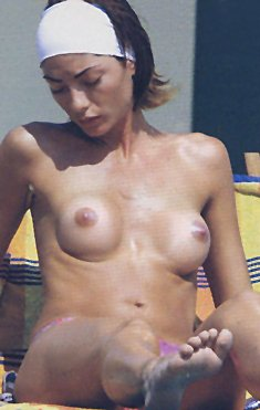 Italian Ilaria Galassi topless on a beach paparazzi photos