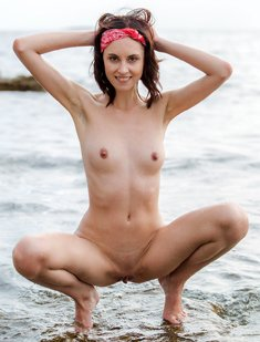 Sabrina G posing nude in the ocean