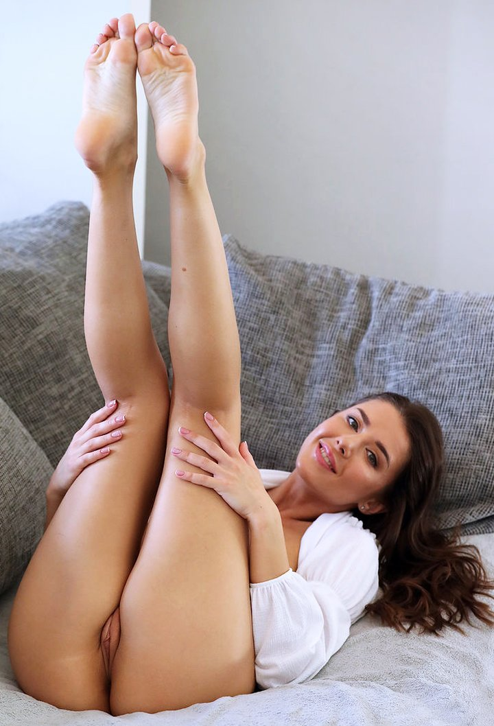 Young sexy brunette Sybil showcases her trimmed pussy