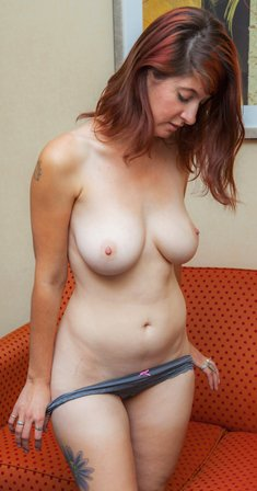 Busty redhead Ashlynn Brooks stripping to show her sexy naked body