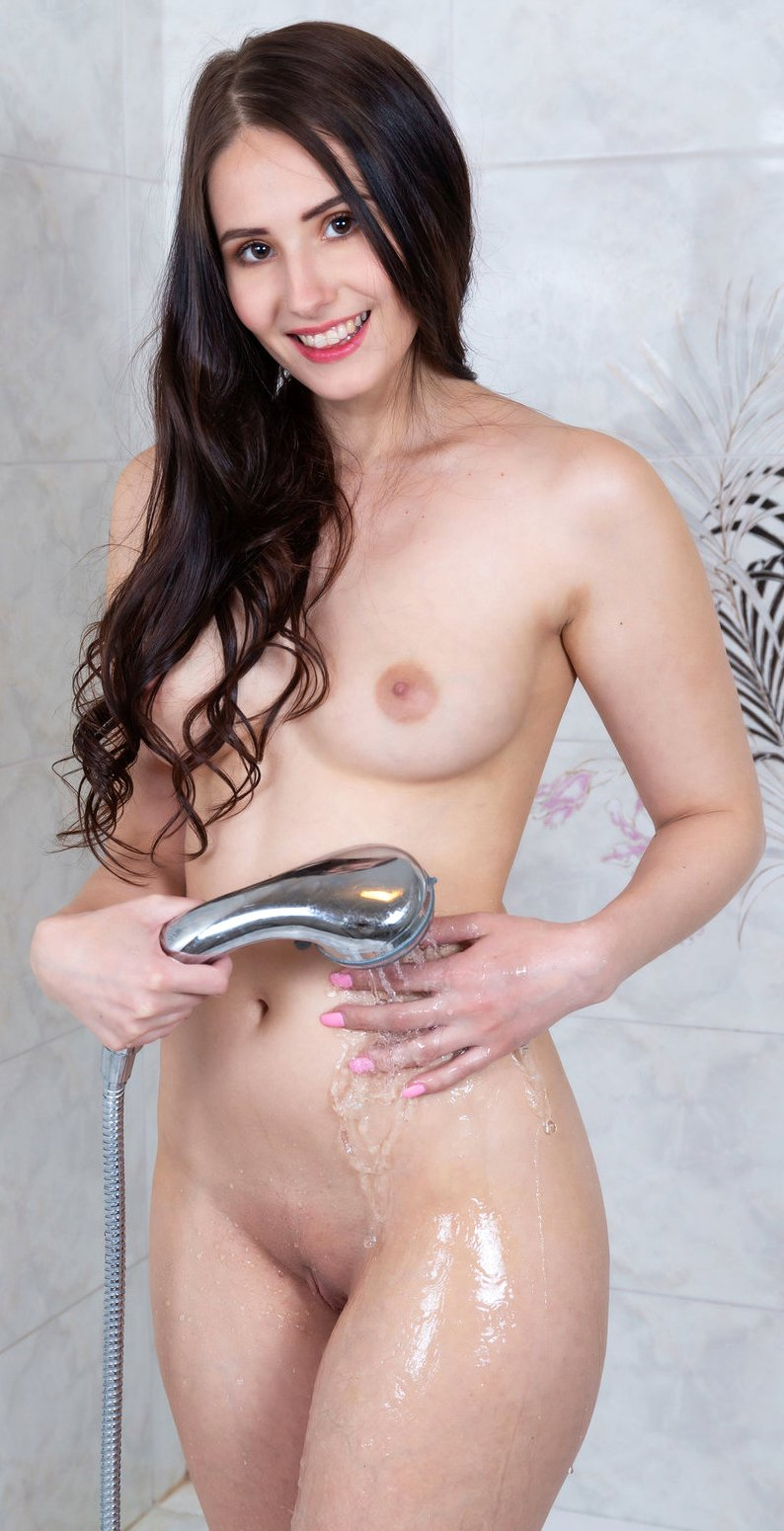 Cute brunette Vanessa A washing naked body in bathtub