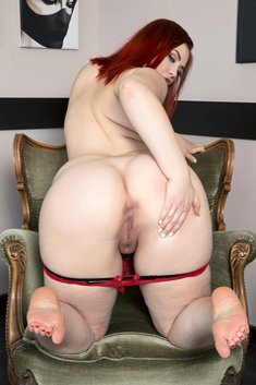 Alexsis Faye shows her wonderfully big tits and sexy ass on a chair