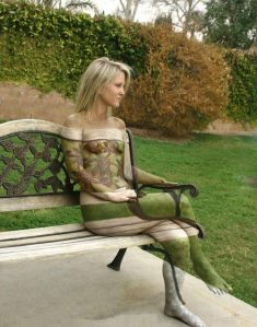 Invisible naked blonde girl outdoors on a bench