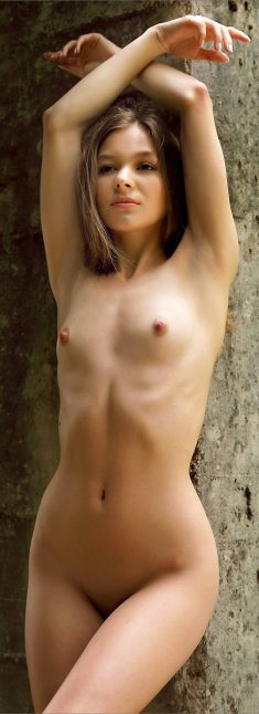 Young cute girl Stefani posing nude in nature