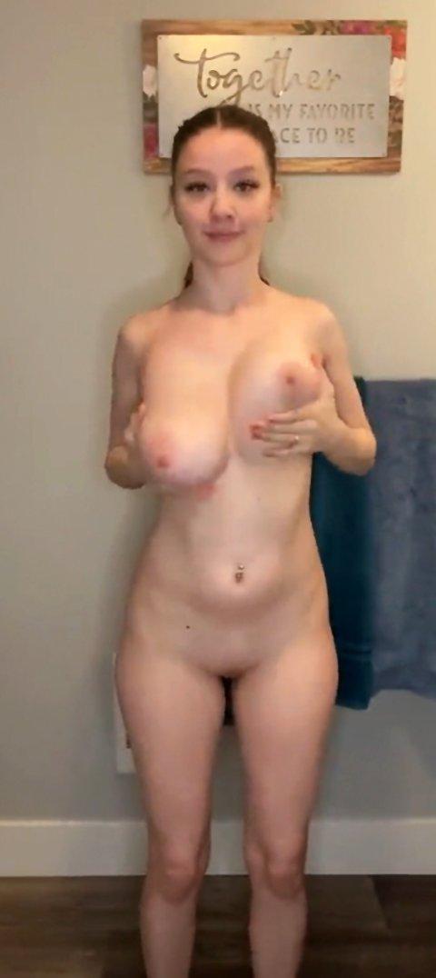 Cute busty girl showing off an impressive striptease