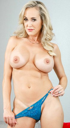 Hot MILF Brandi Love removes her dress and flaunts her huge fake tits and sexy ass