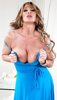 Hot MILF Farrah Dahl showing off massive boobies
