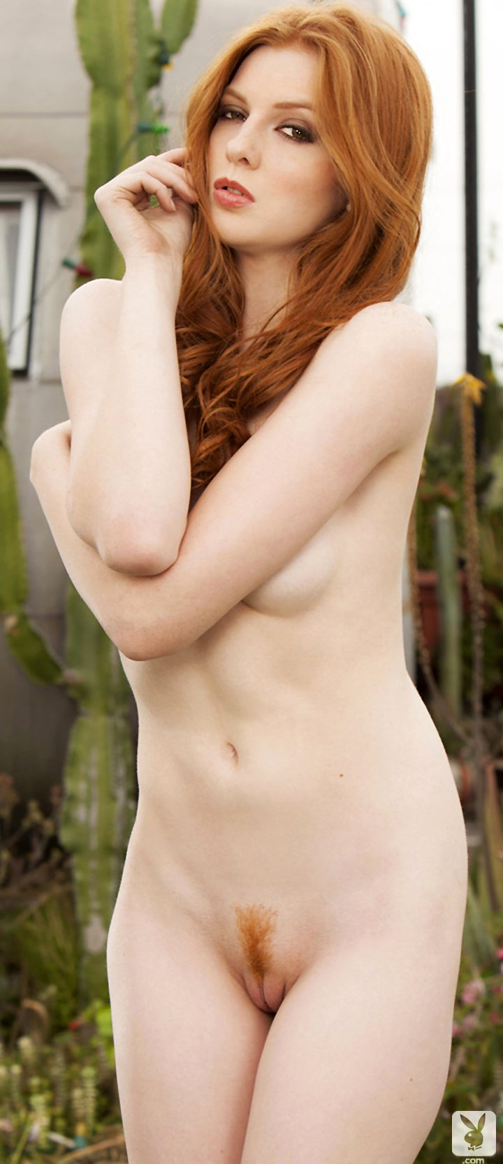 Redhead with tiny tits Shaun Tia posing naked in the garden