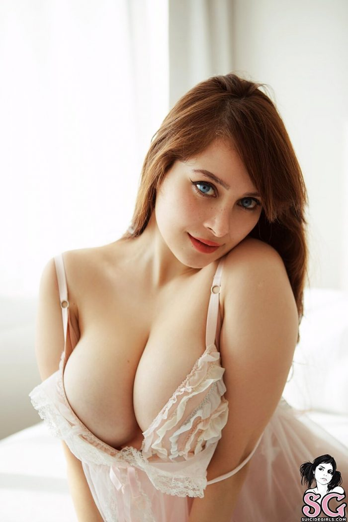 Busty redhead in bedroom