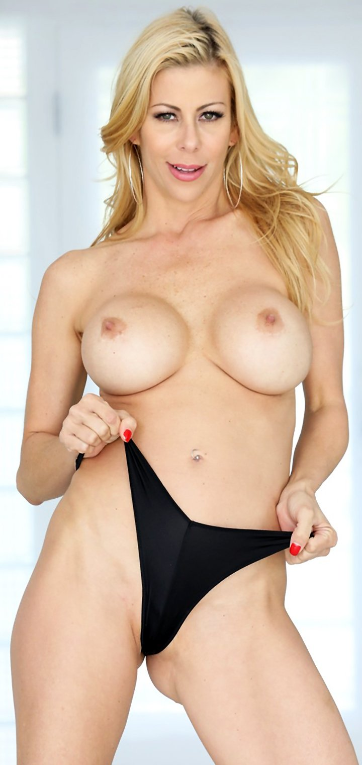 Alluring blonde Alexis Fawx undresses to shows her big fake tits