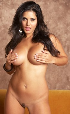 Busty brunette Sunny Leone strips and shows her trimmed pussy