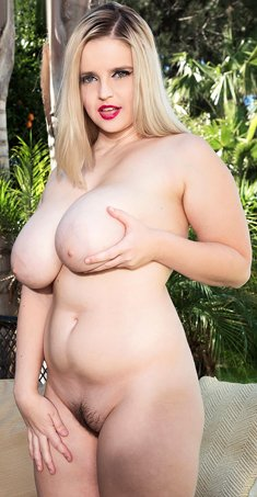 Chubby blonde Codi Vore exposes her huge boobs on an outdoor couch