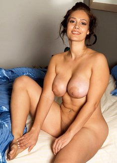 Hot latina Yazmina Melendez undressing to show big nipples