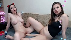 Two slutty lesbians fucking with big double ended dildo