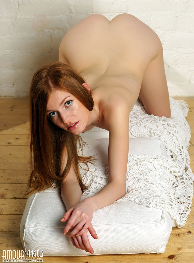Sweet redhead Selena strips and poses naughty on her knees
